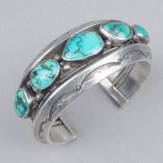 Wide silver cuff with five turquoise stones