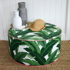 I love the bold green print and the pink piping.   Square Fox Green Palm outdoor pouf ottoman by SquareFoxDesigns