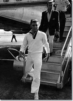 Elvis getting off plane after sleeping