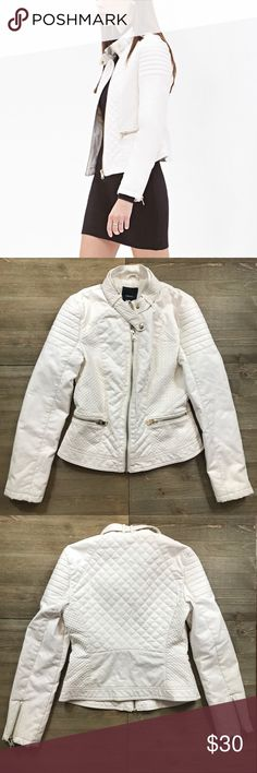 "Forever 21 Vegan Leather Quilted Moto Jacket Forever 21 white Quilted faux leather jacket. Moto style. Zippered pockets and zippered openings on the sleeve. There is some slight discoloring on the inside part of one of the sleeves. Not noticeable when zipped. Pit to pit 16.5"" shoulder to hem 21.5"". Measurements are approximate and taken while laying flat and zipped up. Forever 21 Jackets & Coats"