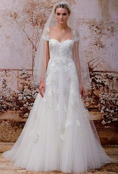 Monique Lhuillier: buy this dress for a fraction of the salon price on PreOwnedWeddingDresses.com