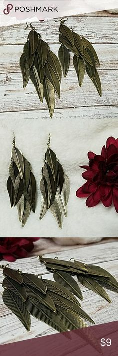 "Bronze Leaf Drop Earrings 5"" in length and about 1.5"" across while hanging. Fishhook backs w/rubber stoppers. 9 Leaves each earring(about 1.5"") Item#E1263 *ALL JEWELRY IS NWT/NWOT/UNUSED VINTAGE* 25% OFF BUNDLES OF 3 OR MORE ITEMS! **REASONABLE OFFERS ACCEPTED** BUY WITH CONFIDENCE~TOP 10% SELLER,FAST SHIPPER, 5 STAR RATING, FREE GIFT w/MOST ORDERS! Wet Seal Jewelry Earrings"
