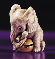 """""""Small Elephant Learning Prayers"""" carved from stag antler by contemporary artist, Kiho Takagi, From the collection of the Kyoto Seishu Netsuke Art Museum"""