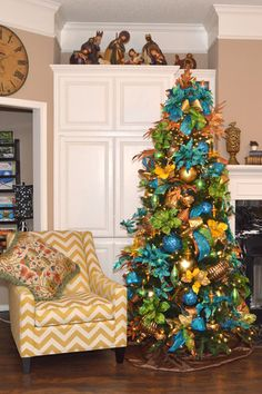 Majestic Peacock Christmas Tree Theme - shades of Turquoise with green and gold will dress up a dining room or living room for the Holidays