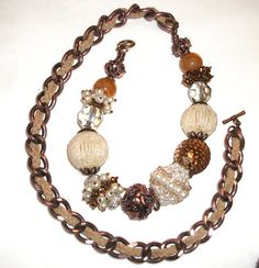 """Necklace """"Vintage look"""" copper colored brass chain with braided leather cord. Fantasy pearls entirely handmade. """"T"""" Closure"""