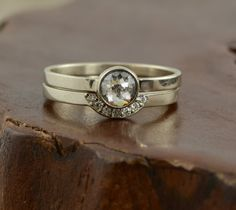 Rose cut diamond engagement ringThis ring is made of eco friendly recycled 14k white gold. The diamond has been set in a hand crafted low profile bezel setting. The diamond is a top quality hand faceted rose cut diamond. The diamond is ...