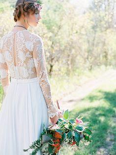 Beautiful boho wedding dress. Photography : Alexandra Elise Photography Read More on SMP: http://www.stylemepretty.com/new-york-weddings/ithaca/2016/08/26/firelight-camps-inspiration-shoot/