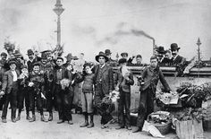 Young flower sellers outside Flinders Street Station in Melbourne in 1902. The Age Archives.