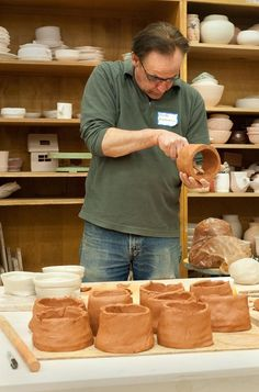 Rob Fornell trimming the inside of some hand-built tea bowls that have yet to have bottoms attached