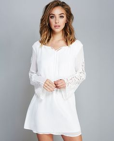 """<p>This pretty peasant dress is everything! Trimmed with girly, sheer floral lace, the dress features a woven body, a tie-front bodice, relaxed long sleeves, and an elasticized waistband.</p>  <p>Model wears a size small.</p>  <ul> <li>Scoop Neckline / Self-tie</li> <li>Long Sleeves</li> <li>Pull-on Construction</li> <li>Skirt Is Lined</li> <li>34"""" From Shoulder to Hem</li> <li>Polyester / Cotton / Nylon</li> <li>Hand Wash</li> <li>Imported</li> </ul>"""