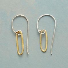 CURSIVE EARRINGS - Like exercises in penmanship, 18kt gold plated hoops sway beneath curvaceous sterling silver wires. Exclusively for Sundance.