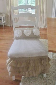 A Ruffled skirt for a dining room chair, too cute! From junk Chic Cottage.   Follow me for great DIY home decor ideas!