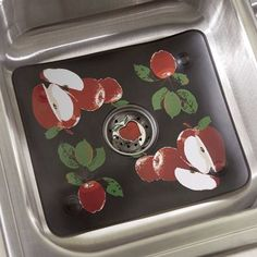Protect dishes and glassware from hard bumps in the sink with this vinyl sink mat made slip proof with suction cups. Comes with matching sink strainer/drain plug.