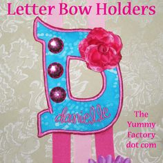 In the hoop bow holder.  Monogram letters embroidery.  Perfect gift for a little girl