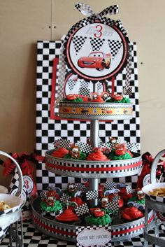 Decorate cupcake stand with ribbon and top cupcakes with cars