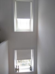 Blackout roller blinds on staircase sash windows | Made to measure | Dalston | Modern white interior