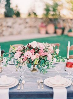 Can't get enough of this soft pink, slate blue, and cranberry color palette for an outdoor wedding reception. Beautiful! Photo: Michelle March via Glamour and Grace