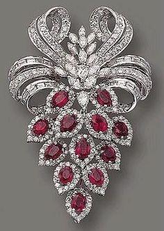 Ruby and diamond brooch #rubyjewelry #GemstoneBrooches #diamondbracelet #DiamondBrooches