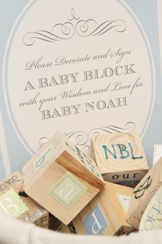 Decorate Baby Blocks as a keepsake - from a ridiculously pretty shower, but I'm thinking Blocks would be adorable First Birthday keepsakes as well - look into DIY blocks for toddlers...