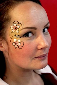 A Very Detailed Flower Face Paint Design.