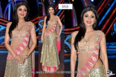 Goergeous Bollywood Actress Shilpa Shetty wearing a lovely golden and pink lehenga saree.