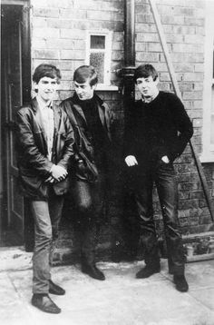 Circa 1960: Liverpudlian skiffle beat band The Beatles standing outside Paul's Liverpool home (left to right) George Harrison (1943 - 2001), John Lennon (1940 - 1980), Paul McCartney. Ringo Starr was not to join the band for another two years.