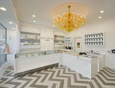 Yellow chandelier in white & grey macaron shop