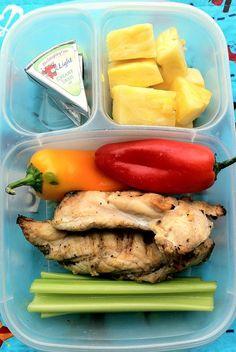 Husband's Lunch: grilled chicken left over from a playdate/BBQ. He has two pieces of chicken, surrounded by celery, sweet baby peppers, pine...
