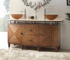bathroom with two wooden round sinks