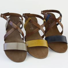 Leather sandals by Elk in brown, mustard yellow and dark blue.