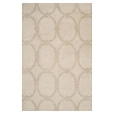 Anchor your living room seating group or define space in the den with this artfully hand-tufted New Zealand wool rug, showcasing a circle-link motif in deser...