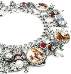 "My jewelry store features handmade jewelry, charm bracelets, necklaces, earrings, this lovely "" Alice in Wonderland"" charm bracelet and over 400 more unique jewelry designs. Find many Alice in Wonderl"