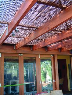 Add bamboo shade cover to pergola. This would be as a great idea as a wall keep the sun out but let the air and some view still through too.