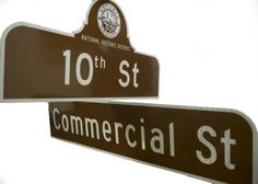 Walking around downtown Astoria, you might notice the fading green and white street signs dating back to the with their oversized, aftermarket, off-color toppers with Astoria's city seal. Street Name Sign, Custom Street Signs, Street Names, Freemason Sign, Commercial Street, Off Colour, Historical Sites, Main Street