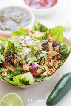 This Chipotle copycat Whole30 carnitas bowl is a take on the Whole30 Chipotle favorite: romaine loaded with tender carnitas, guac, and flavorful salsas.
