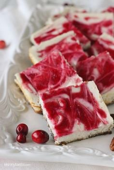 Cheesecake squares with a cranberry swirl and a gingersnap pecan crust – so good, less guilt and perfect for the Holidays!