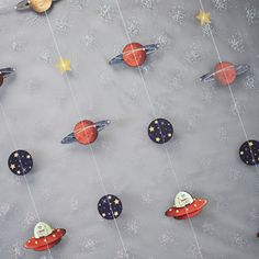 Amazing space adventure back drop featuring rocket ships, UFO's, stars and planets.