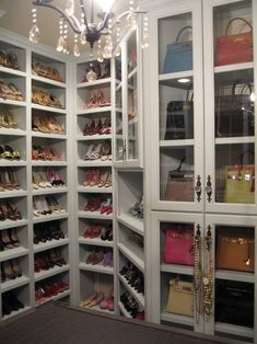 cabinet for purses and shelves for shoes.. this would be so freakin awsome to have!  Its so sex in the city! Lol