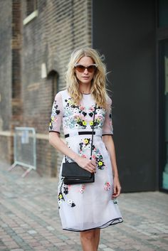 pretty dress offset by a tough black bag // love the floral details