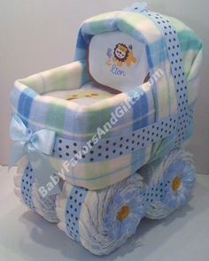 Baby Boy Diaper Cakes | Baby Boy Carriage Diaper Cake | Unique diaper cakes  Mom you could do something like this and add penguin to it