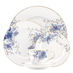 Inspired by toile artistry, Garden Grove fine china features a monochromatic floral motif, in rich shades of blue. Sparkling gold leaves give this pattern an updated look and each piece is trimmed in gold for the perfect finishing touch.