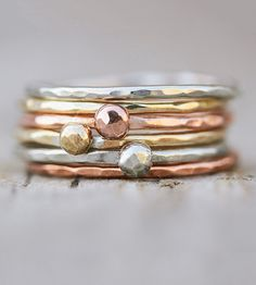 Mix and match these fine metal button bands to create an endless supply of multi-layered looks.