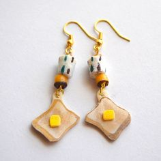 Toast earrings(Plastic, Ghanaian beads, and other parts)トーストピアス(プラバン、ガーナのトンボ玉、その他)  By NanaAkua  http://on.fb.me/15hCkJy