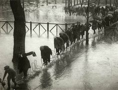 Chairs bridge in Paris: This was a picture taken during a heavy flooding in Paris in 1924. People improvised a bridge made with chairs to cross the street.