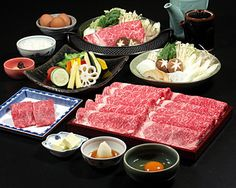 Shabu-shabu is a Japanese dish featuring thinly sliced beef boiled in water. The term is an onomatopœia, derived from the sound emitted when the ingredients are stirred in the cooking pot.