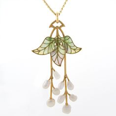 A French Art Nouveau 18 karat gold and plique-à-jour enamel pendant with pearls by G. Fouquet. The pendant features 3 freshwater pearls on two articulated stems dropping from 3 plique-à-jour enamel leaves.