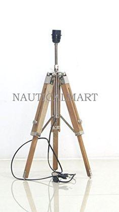 NauticalMart Natural Wooden Tripod Table Lamp Stand NAUTI... https://www.amazon.com/dp/B077KZPCBY/ref=cm_sw_r_pi_dp_U_x_aDirAbYAC8MVN