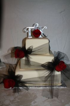 Not sure about the topper, but I LOVE the tulle wrapped around the tiers.