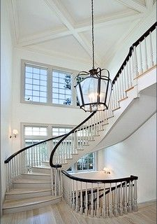Contemporary Federal style. That is one beautiful staircase.