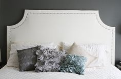 Going to try this DIY headboard.. With a more fun fabric and nailhead design